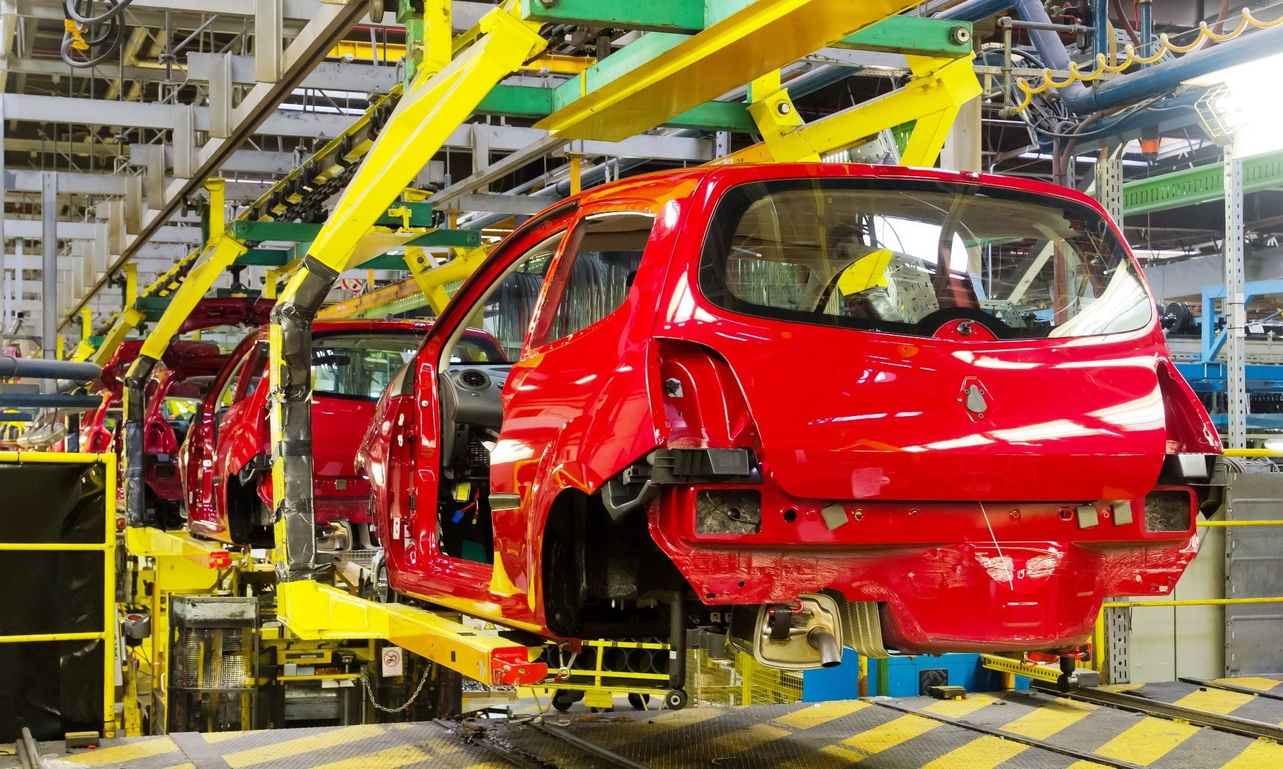 How do manufacturers protect their bottom line against currency rate movements?