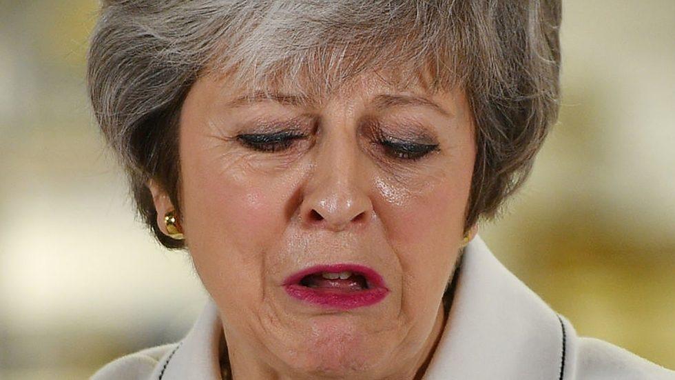 Theresa May defeated